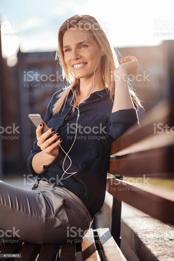 Girl enyoing uplifting tunes and sunny day stock photo