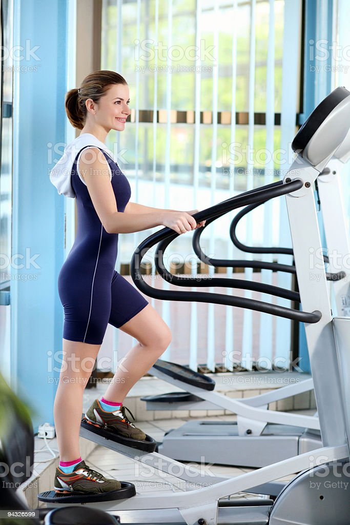 Girl exercising in a fitness center. royalty-free stock photo
