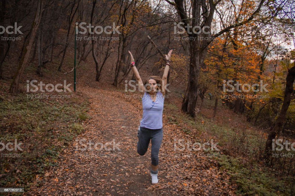 Girl exercising in a park stock photo