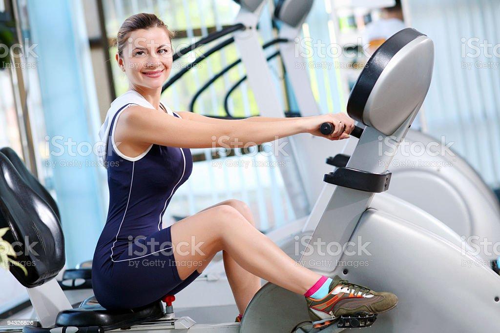 Girl exercising in fitness center. royalty-free stock photo