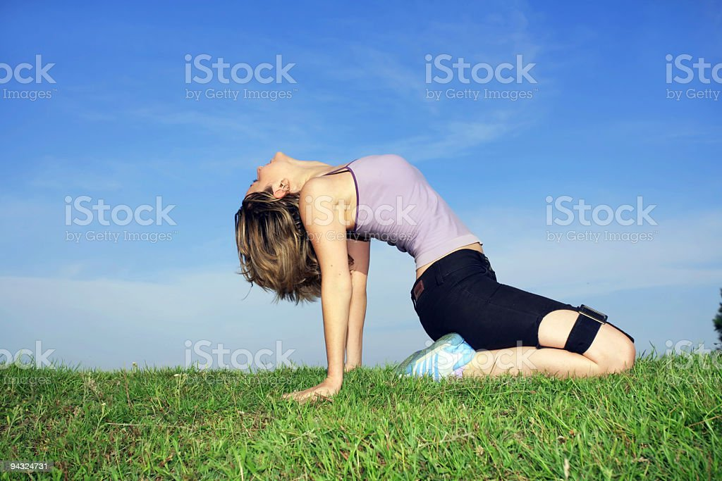 Girl exercising in park royalty-free stock photo