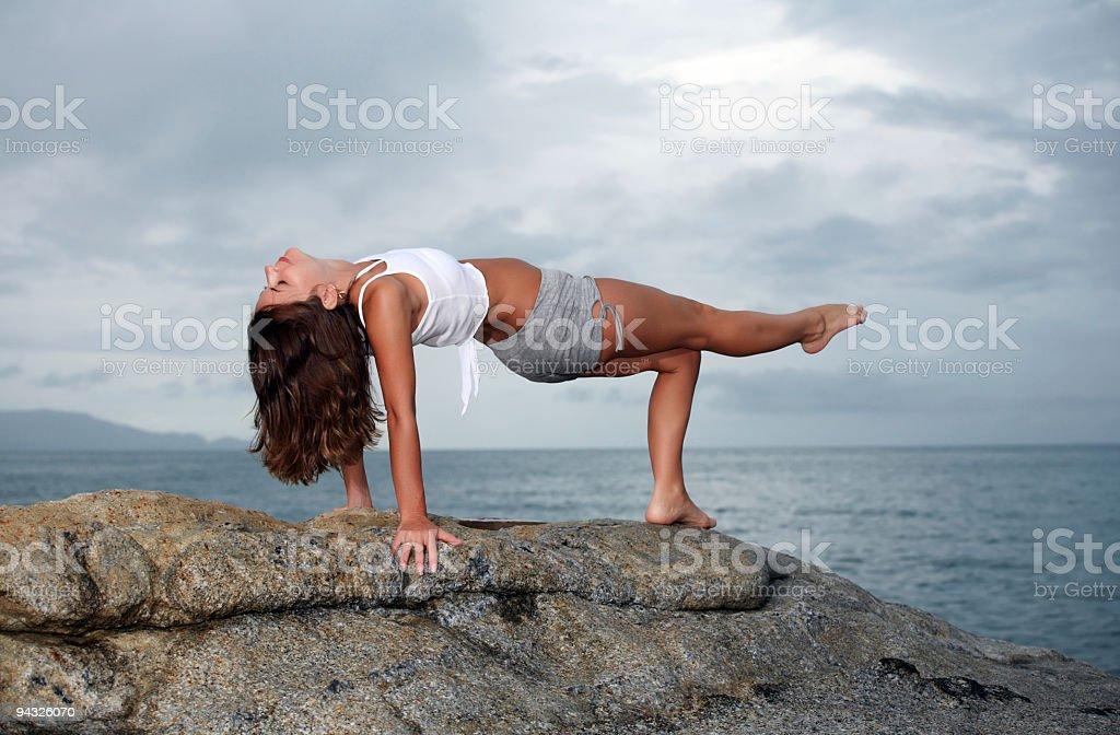 Girl exercising on mountain. royalty-free stock photo