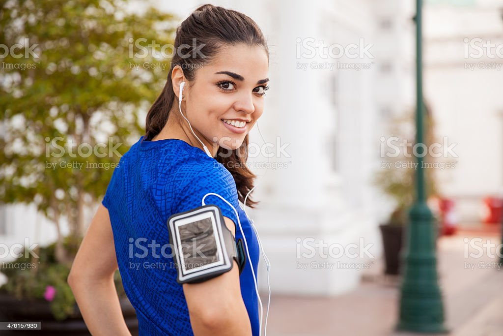 Girl exercising with music stock photo