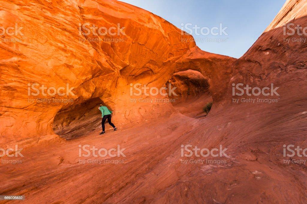 Girl explores Anasazi dwelling in Mystery Valley, AZ stock photo
