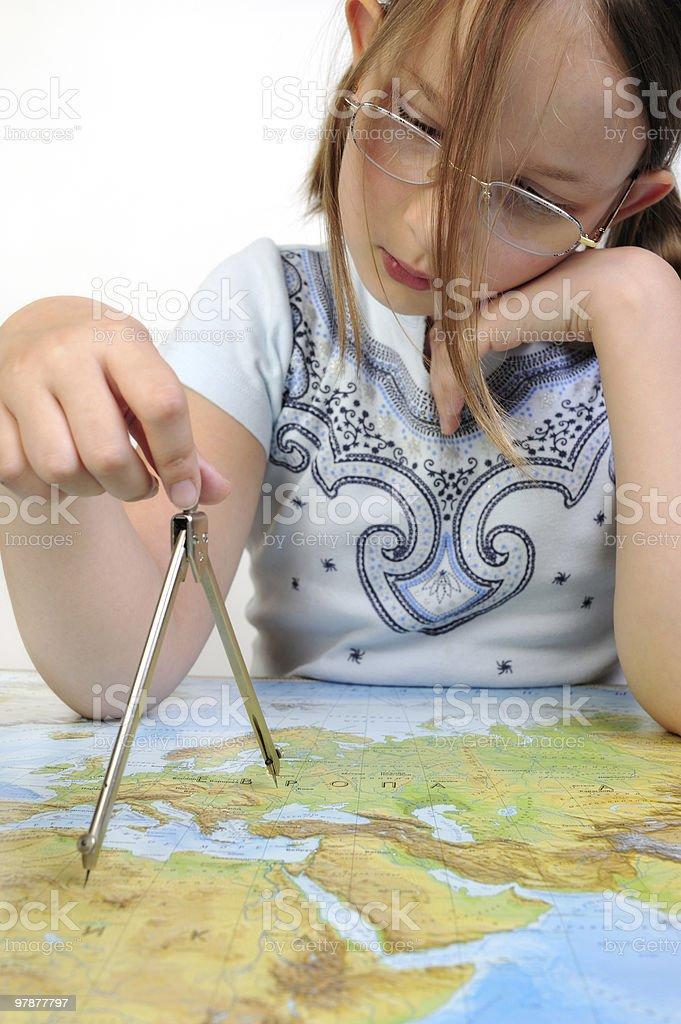 Girl exploring the map of Eurasia stock photo