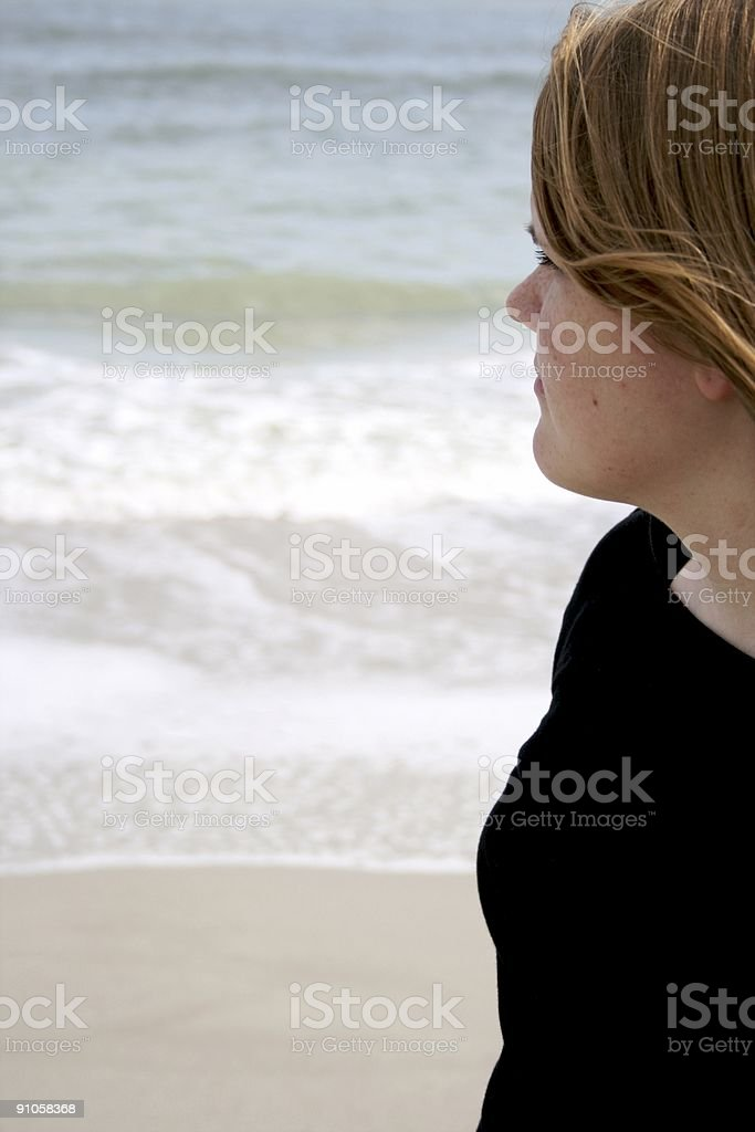 Girl Face in Profile Gazing at Ocean royalty-free stock photo
