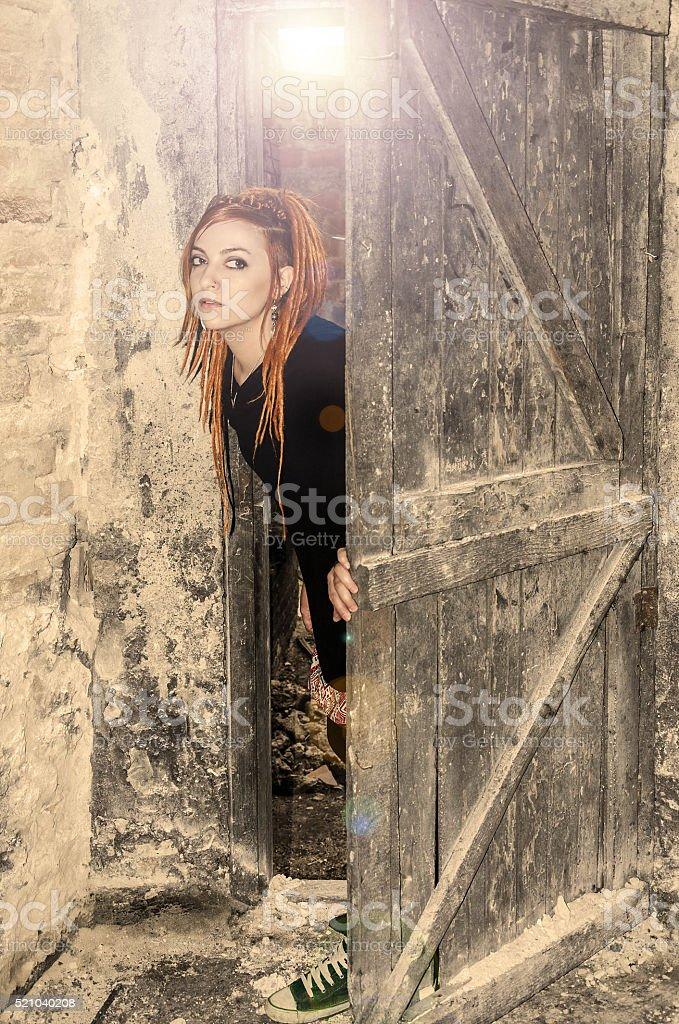 Girl fairytale sources whose big old door stock photo