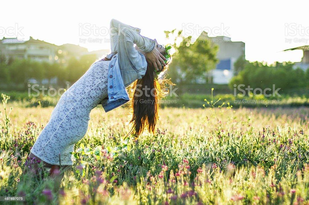 girl falling in a field stock photo