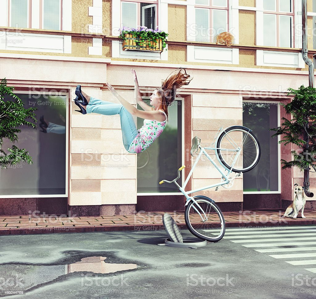 girl falling off her bicycle stock photo