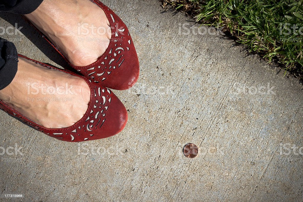 Girl Finds a Penny stock photo
