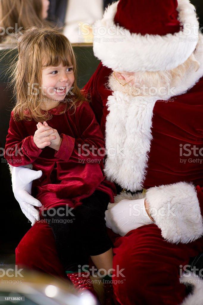 Girl Finds Santa on Public Transit royalty-free stock photo