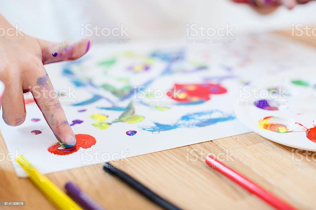Girl finger painting stock photo