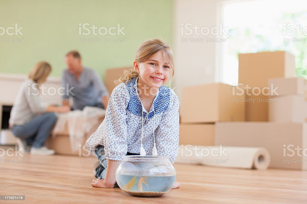 Girl fish bowl in her new house royalty-free stock photo