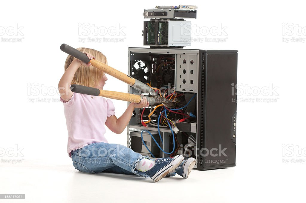 Girl 'fixing' a computer with hedge clippers. royalty-free stock photo