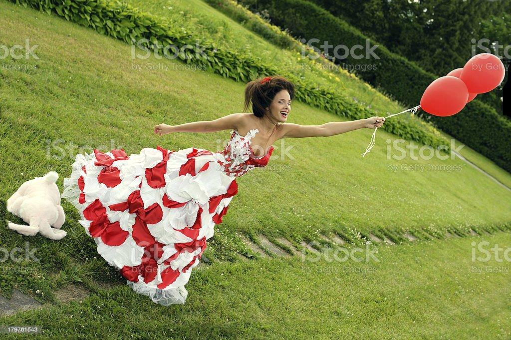 girl flies on balls royalty-free stock photo