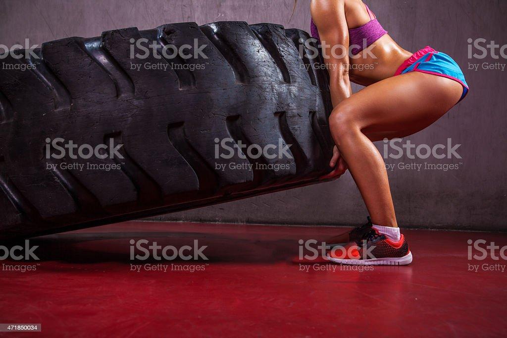 Girl Flipping Big Tire stock photo