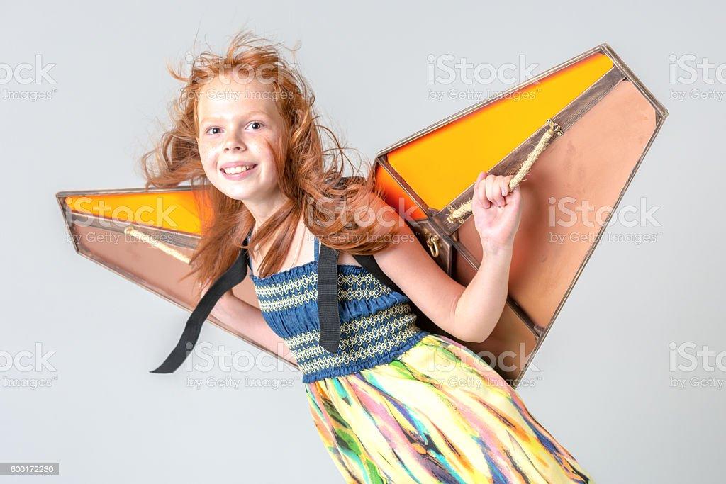 Girl Flying On Kite Wings stock photo