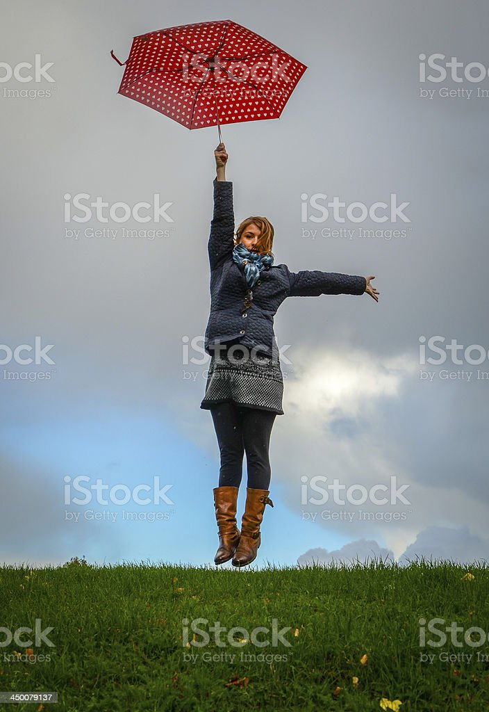 Girl flying with umbrella stock photo