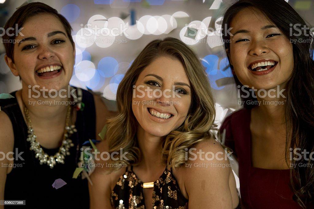 Girl Friends Celebrating New Years stock photo