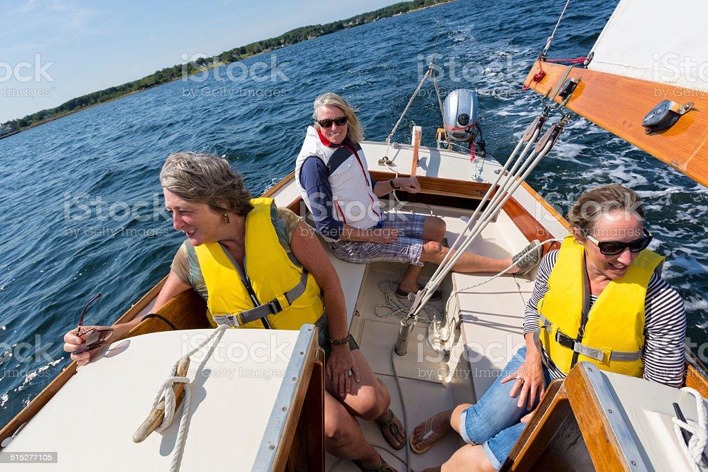 Girl Friends Enjoying a Day of Sailing stock photo