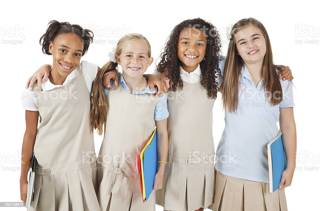 Girl friends in school uniforms on white background royalty-free stock photo