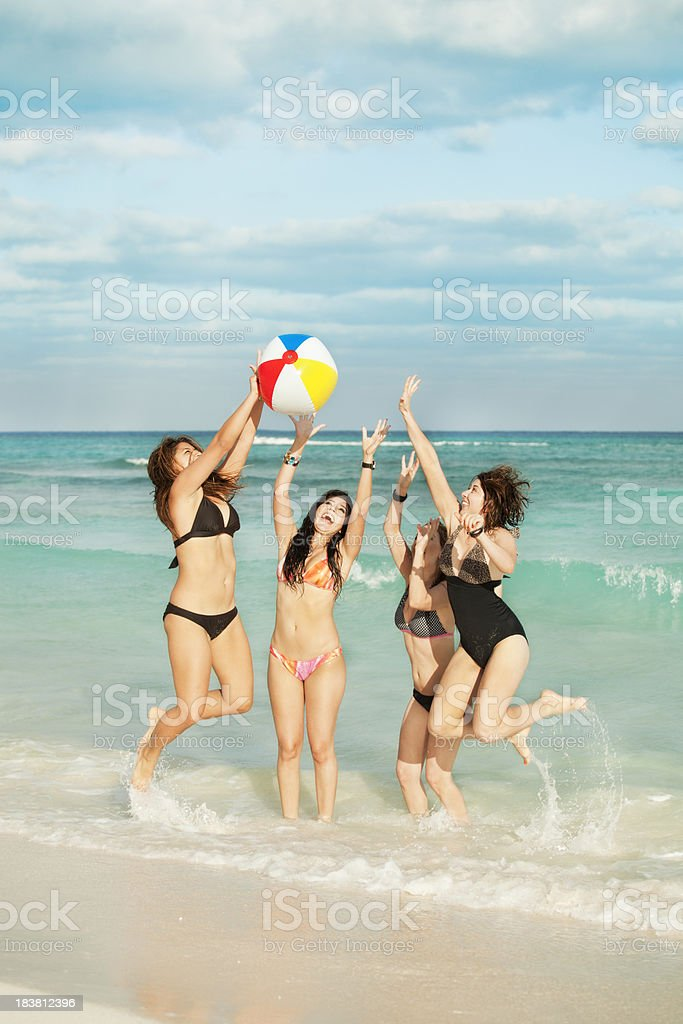 Girl Friends Playing with Beach Ball in Riviera Maya Mexico royalty-free stock photo