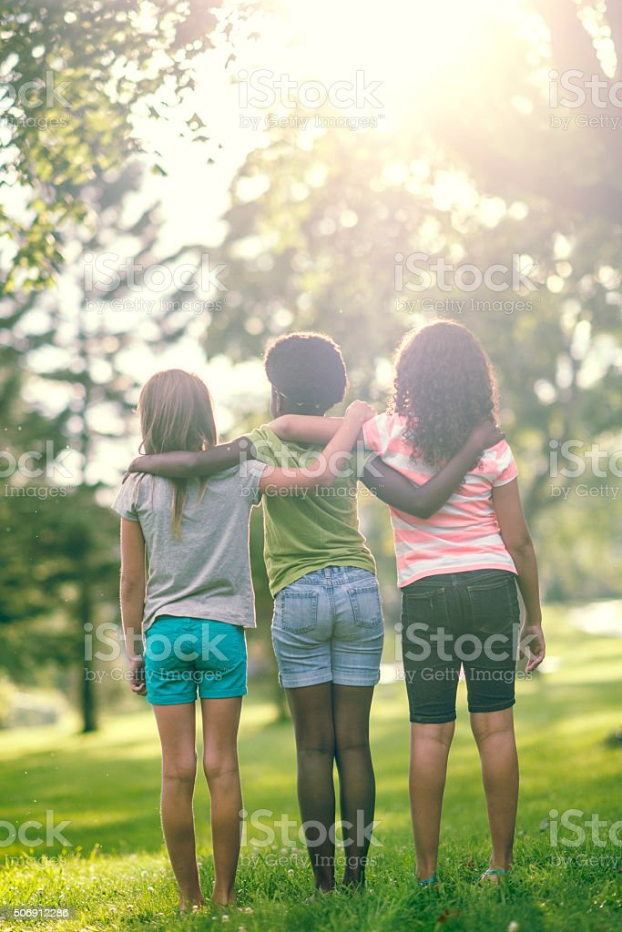Girl Friends Together at the Park stock photo