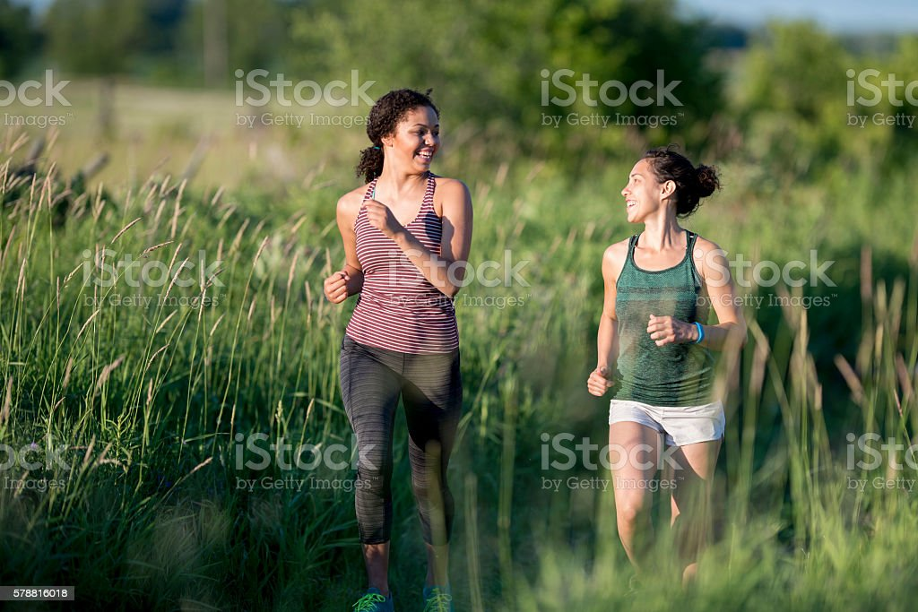 Girl Friends Working Out Together stock photo
