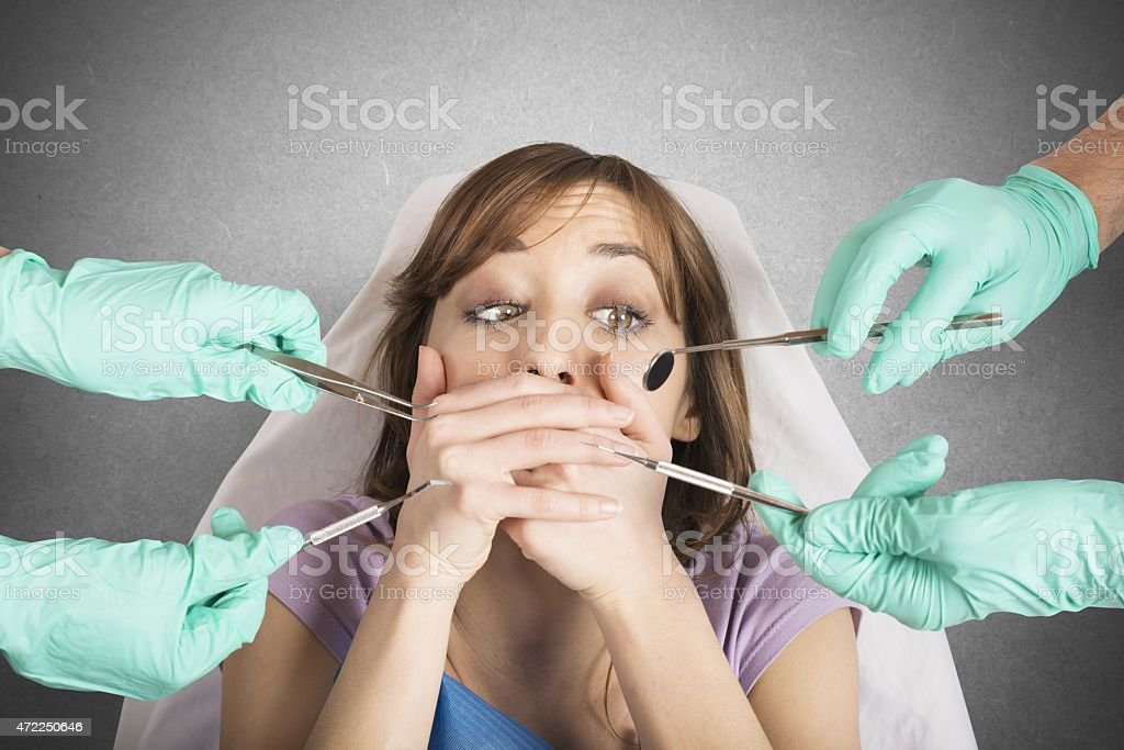 Girl frightened by dentists stock photo