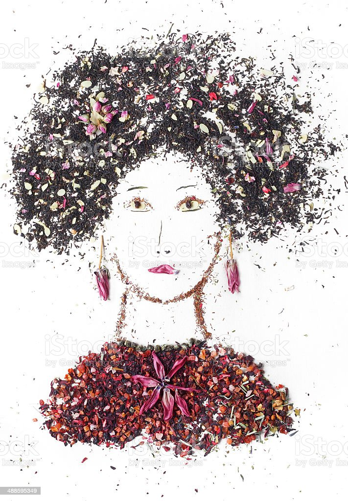 Girl from tea. Handmade portrait of a girl from tea leaves and tea flowers. stock photo