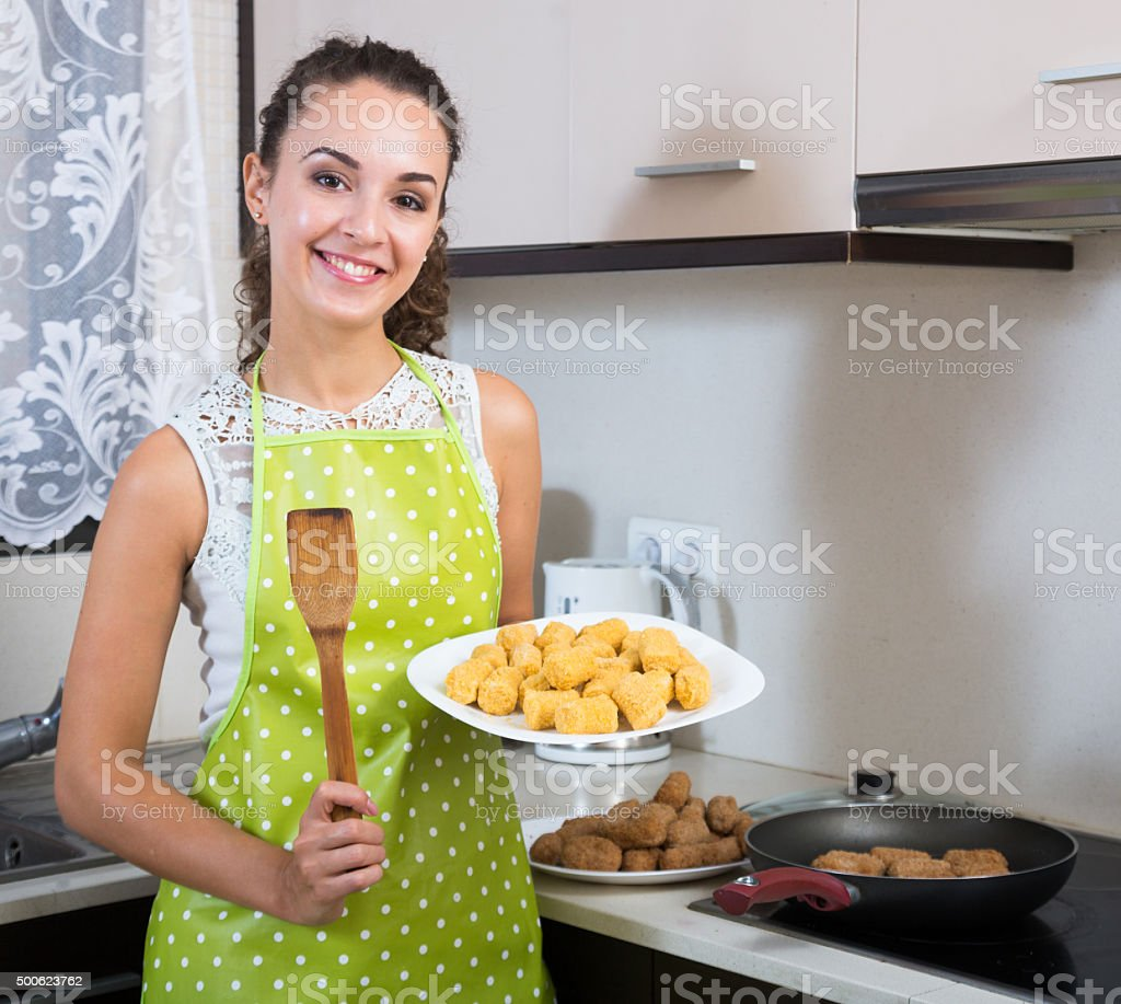 girl frying delicious crocchette stock photo