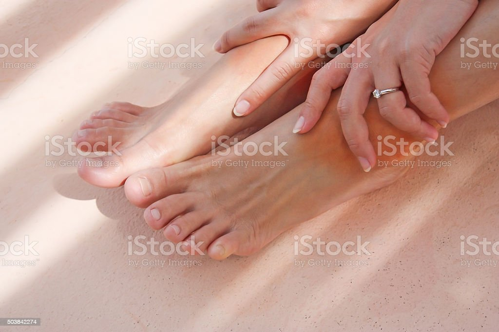 Girl get pain on ankles stock photo