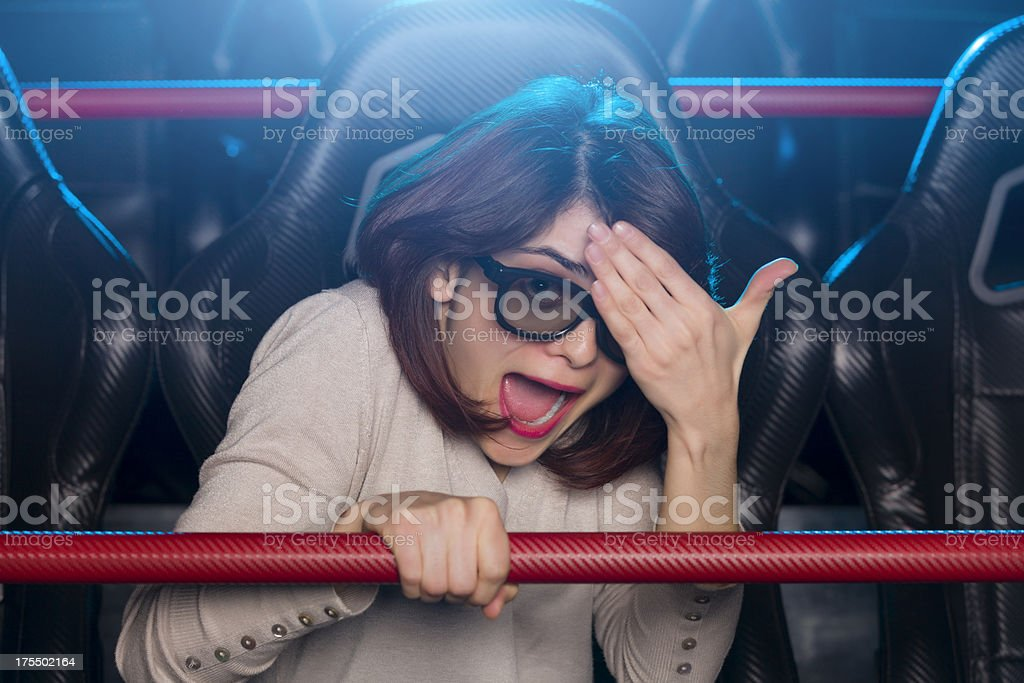 Girl gets a fright in 5d movie royalty-free stock photo