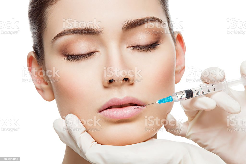 Girl gets injection stock photo