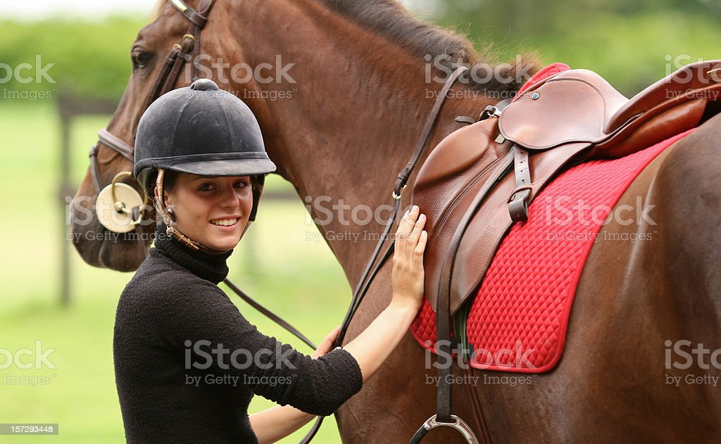 Girl getting ready for horseback riding, Norway royalty-free stock photo
