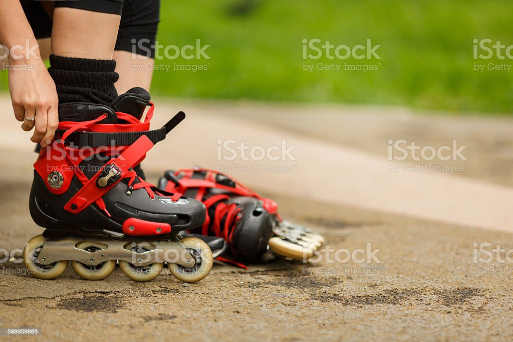 Girl getting ready to ride and wearing red roller blades stock photo