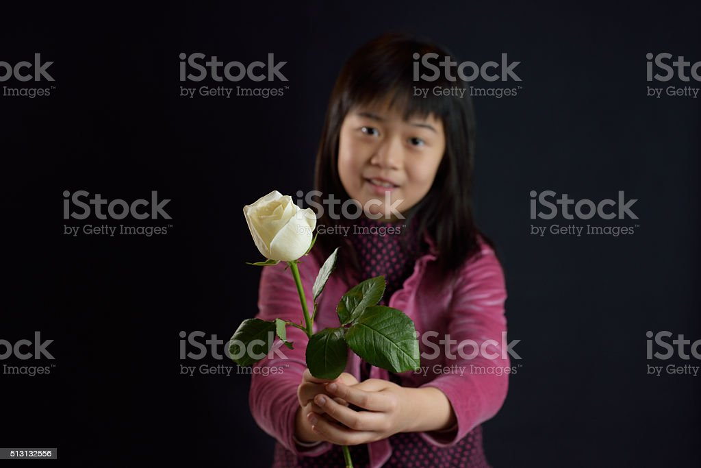 Girl giving a flower stock photo