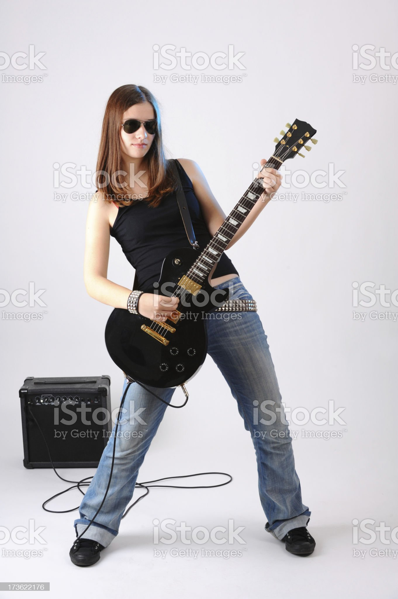 Girl, glasses and guitar royalty-free stock photo