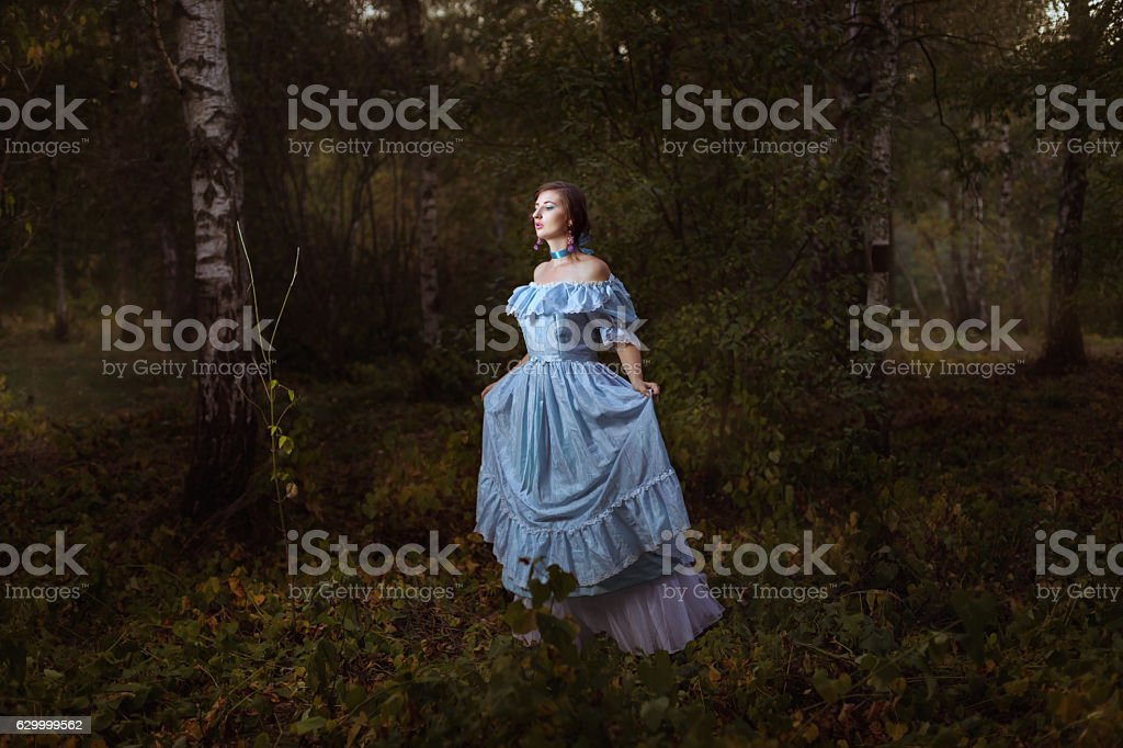 Girl goes through the woods. stock photo