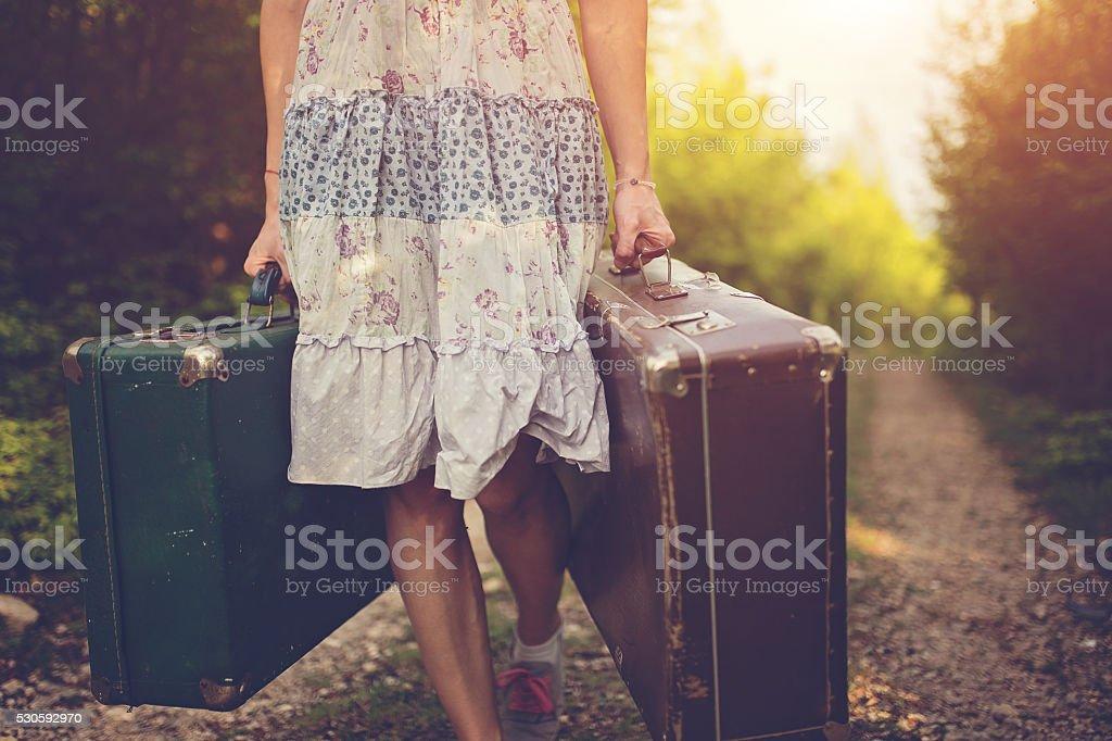Girl going away stock photo