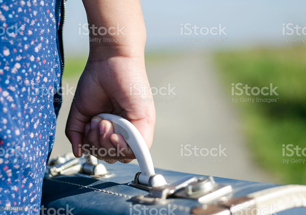 Girl going on the way out in life stock photo