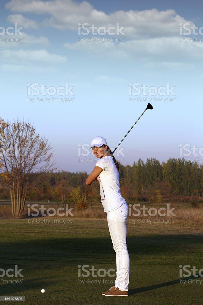 girl golfer ready for shot royalty-free stock photo