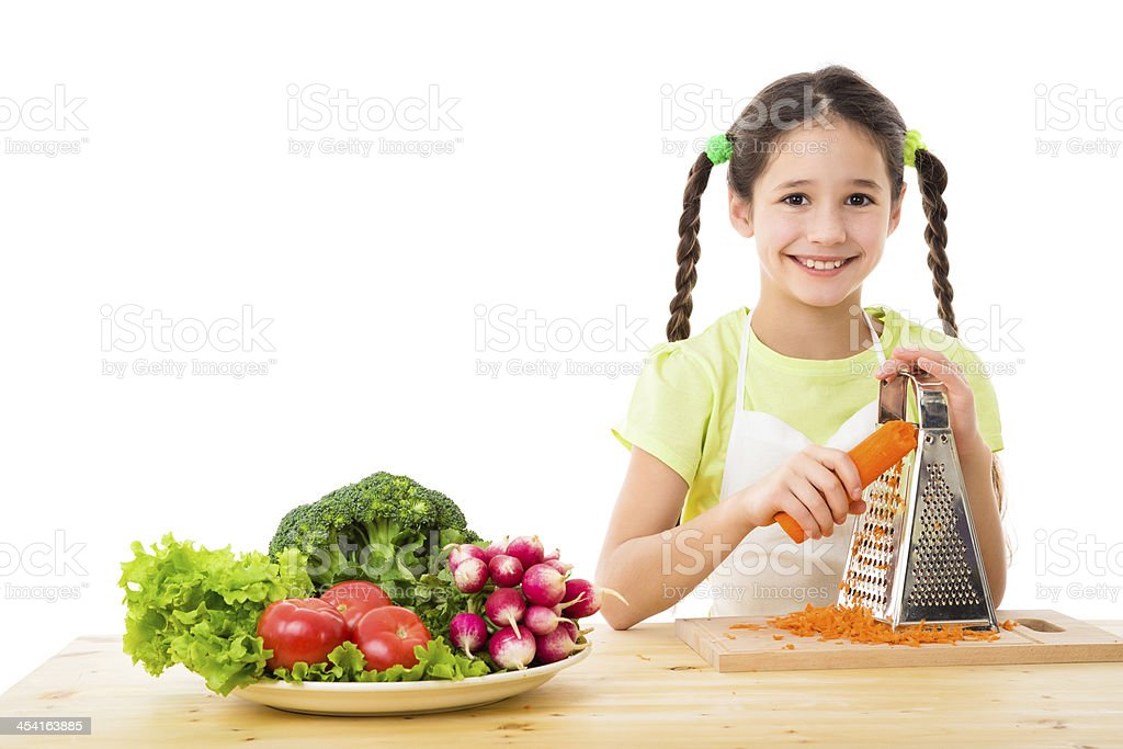 Girl grate the carrots royalty-free stock photo