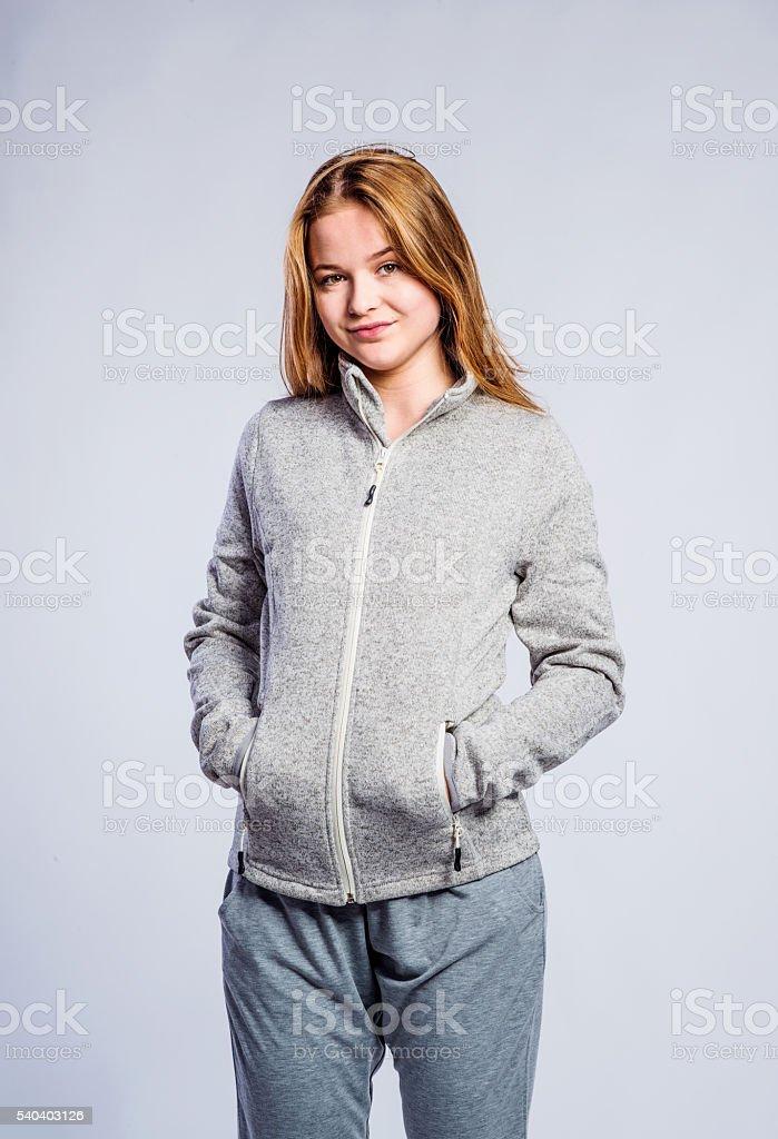 Girl gray hooded sweatshirt, young woman, studio shot stock photo