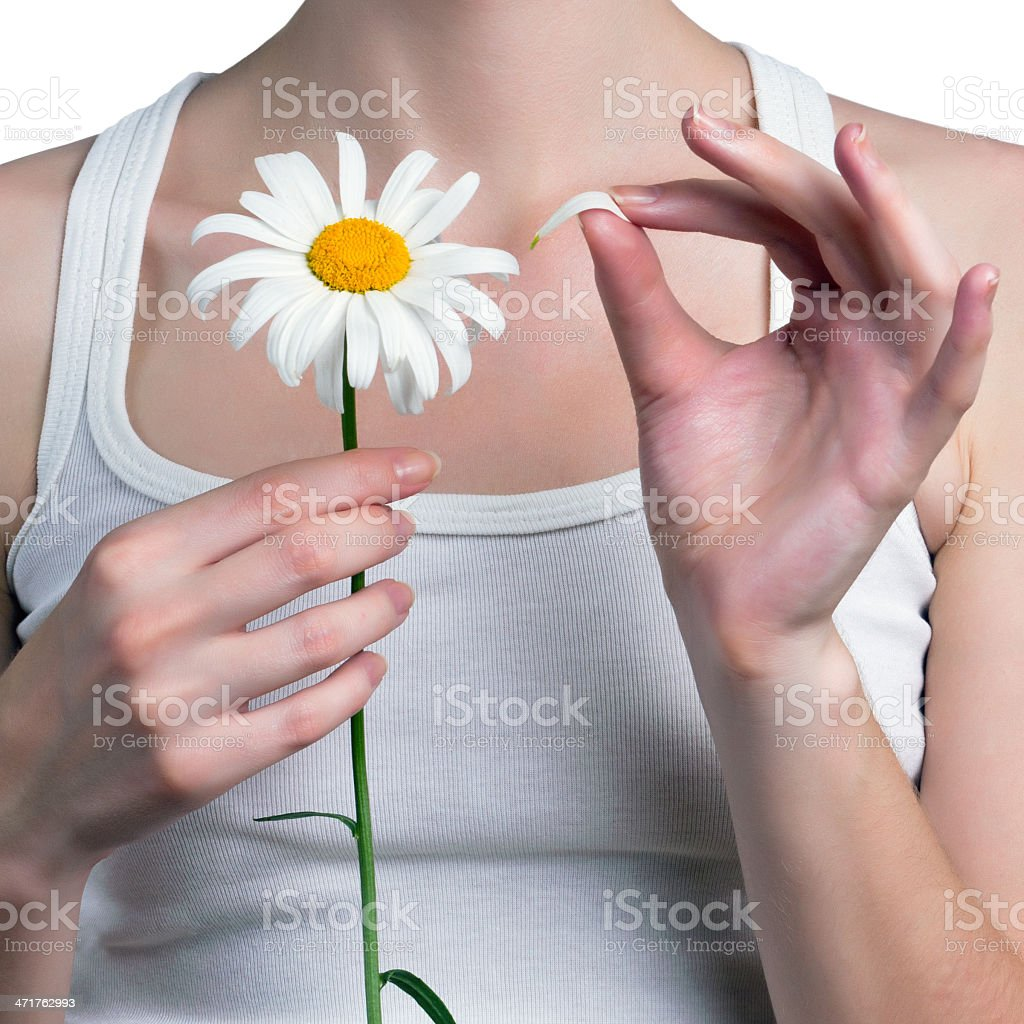 Girl guesses on a flower royalty-free stock photo