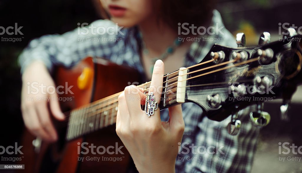 Girl guitarist plays stock photo