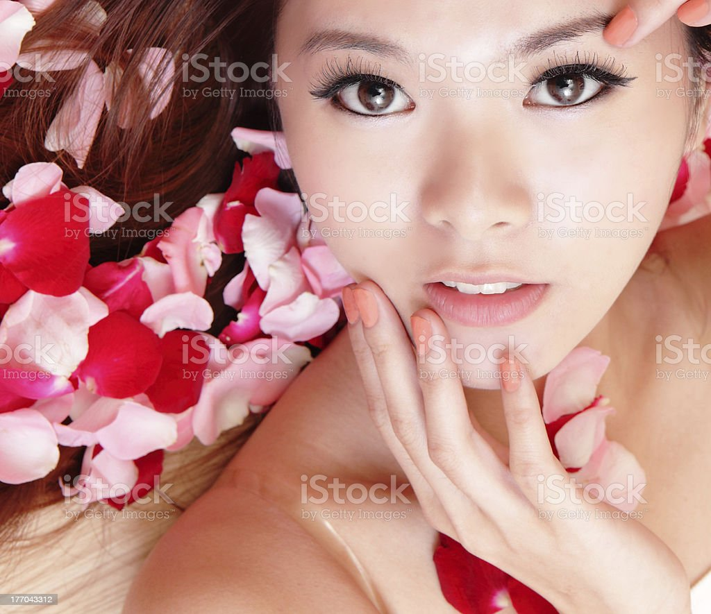 Girl hand touch face with red rose royalty-free stock photo
