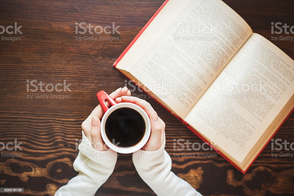 Girl hands holding cup of hot coffee stock photo