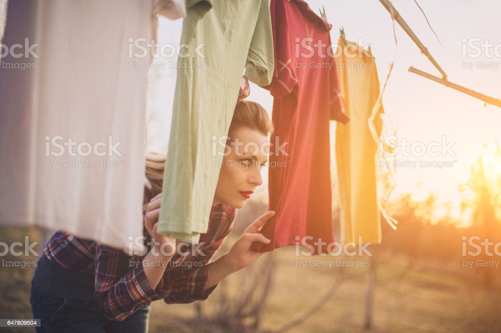Girl has a laundry day outdoors stock photo