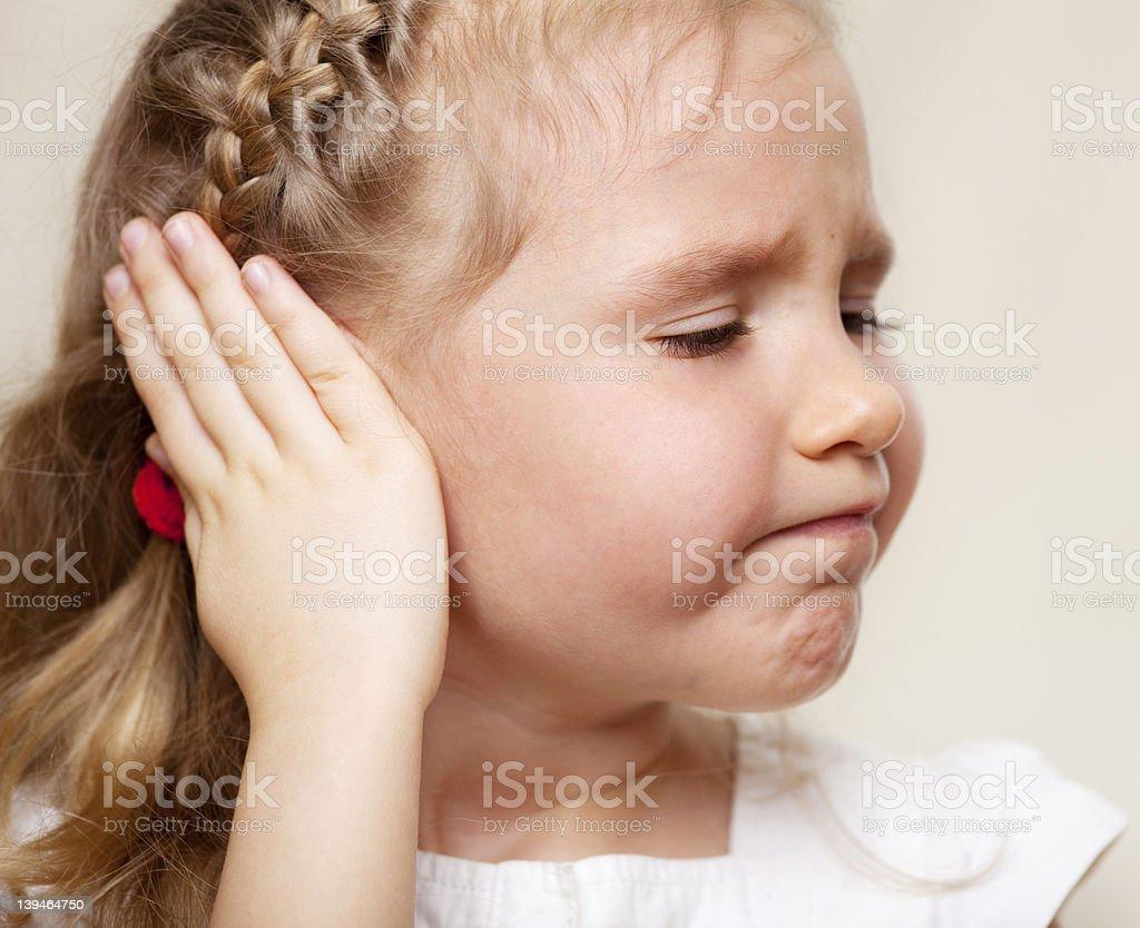 Girl has a sore ear stock photo